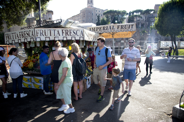Stopping for a snack at Imperial Fruit in front of the Fori Imperiali