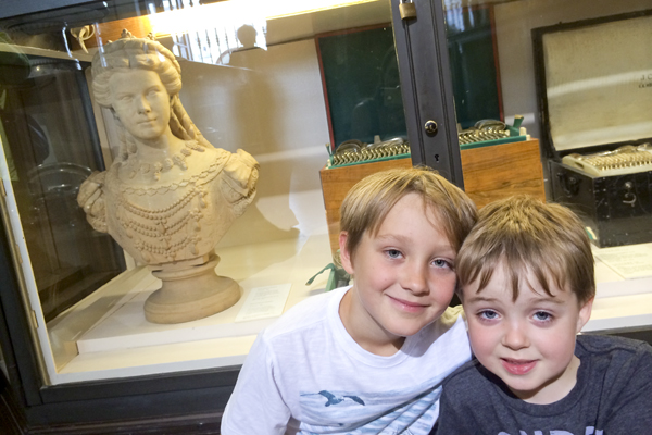 The boys in front of the Bust of Empress Elisabeth (Sisi) in her Hungarian coronation gown.