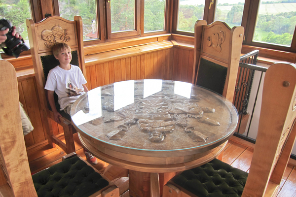 Big Guy sitting inside at one of the intricately carved tables.