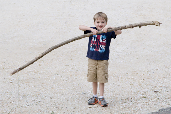 Little Man found a large stick in the parking lot that he was determined to take home