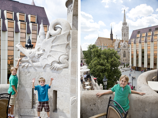 Little Man poses with a gargoyle and Big Guy with a view of Matthias Church in the background.