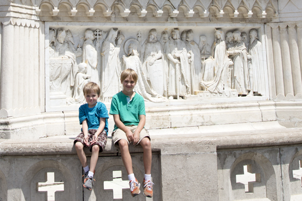 The boys in front of the base of the Saint Stephen Statue