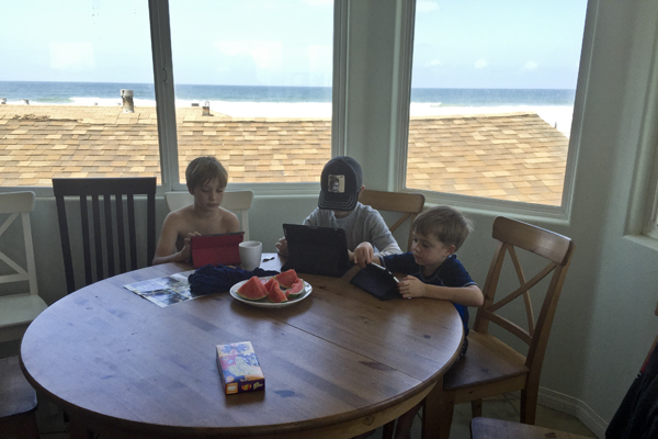 The kids enjoyed video games at the breakfast table while the adults enjoyed the view